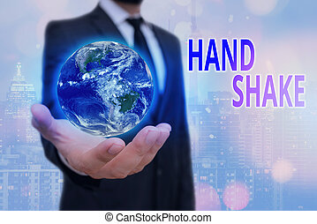 Conceptual hand writing showing Hand Shake. Business photo text an act showing that you have made an agreement or greeting Elements of this image furnished by NASA.