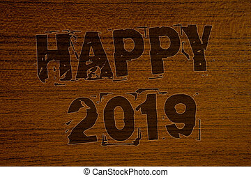 Conceptual hand writing showing Happy 2019. Business photos showcasing New Year Celebration Cheers Congrats Motivational MessageBold brown letters words ideas on wooden background concept messages.