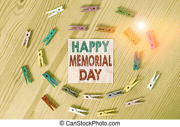 Conceptual hand writing showing Happy Memorial Day. Business photo text Honoring Remembering those who died in military service Colored crumpled papers wooden floor background clothespin.