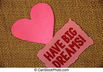 Conceptual hand writing showing Have Big Dreams Motivational Call. Business photo text Future Ambition Desire Motivation Goal Text pink torn paper note heart love message letter.