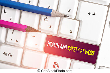 Conceptual hand writing showing Health And Safety At Work. Business photo text Secure procedures prevent accidents avoid danger White pc keyboard with note paper above the white background.