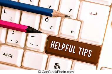 Conceptual hand writing showing Helpful Tips. Business photo text advices given to be helpful knowledge in life White pc keyboard with note paper above the white background.