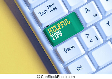 Conceptual hand writing showing Helpful Tips. Business photo text Useful secret Information Advice given to accomplish something White pc keyboard with note paper above the white background.
