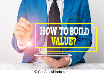 Conceptual hand writing showing How To Build Value Question. Business photo text Ways for developing growing building a business Businessman pointing with pen in empty copy space.