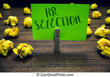 Conceptual hand writing showing Hr Selection. Business photo text Process and approached by human resources when hiring employees Clothespin holding green paper note crumpled papers mistakes.