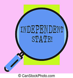 Conceptual hand writing showing Independent State. Business photo showcasing ability of the state to be independent and have autonomy Round magnifying glass with iron handle frame to look bigger.