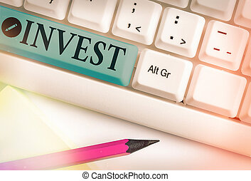 Conceptual hand writing showing Invest. Business photo text commercial venture with the expectation of achieving a profit.
