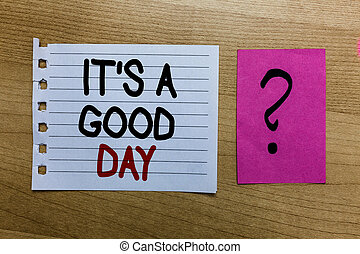 Conceptual hand writing showing It s is A Good Day. Business photo text Happy time great vibes perfect to enjoy life beautiful white page on wooden desk with words violet with question mark.