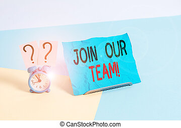 Conceptual hand writing showing Join Our Team. Business photo showcasing invite someone to work together for particular purpose target Alarm clock beside a Paper sheet placed on pastel backdrop.