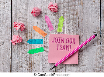 Conceptual hand writing showing Join Our Team. Business photo text invite someone to work together for particular purpose target Note paper and line arrow stickers on the top of wooden table desk.