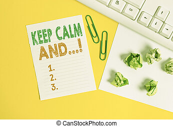 Conceptual hand writing showing Keep Calm And. Business photo text motivational poster produced by British government Flat lay with copy space white paper with paper clips on the table.
