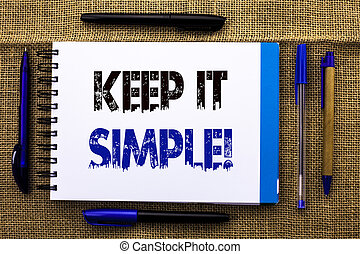 Conceptual hand writing showing Keep It Simple Motivational Call. Business photo text Simplify Things Easy Clear Concise Ideas written on Notebook Book on the jute background Pens next to it.