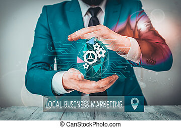 Conceptual hand writing showing Local Business Marketing. Concept meaning Localized specification on Store characteristic Male human wear formal suit presenting using smart device