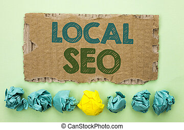 Conceptual hand writing showing Local Seo. Business photo text Search Engine Optimization Strategy Optimize Local Find Keywords written on Tear Cardboard on plain background Crumpled Paper Balls.