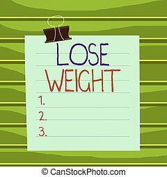 Conceptual hand writing showing Lose Weight. Business photo showcasing the fact of a demonstrating s is or an animal s is body weight becoming less Paper lines binder clip suare notebook color background.