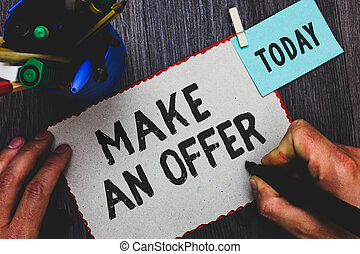 Conceptual hand writing showing Make An Offer. Business photo text Proposal Bring up Volunteer Proffer Bestow Bid Grant Man holding marker paper clothespin reminder cup marker wood table.