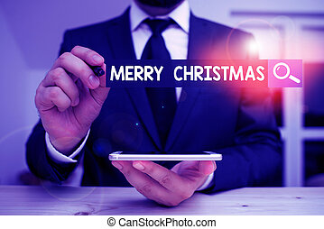 Conceptual hand writing showing Merry Christmas. Business photo showcasing annual tradition to celebrate the birth of Jesus Christ Male human wear formal clothes present use hitech smartphone.