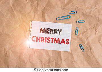 Conceptual hand writing showing Merry Christmas. Business photo showcasing annual tradition to celebrate the birth of Jesus Christ Papercraft desk square spiral notebook office study supplies.
