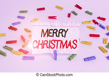 Conceptual hand writing showing Merry Christmas. Business photo showcasing annual tradition to celebrate the birth of Jesus Christ Colored clothespin papers empty reminder white floor office.