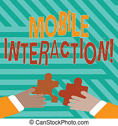 Conceptual hand writing showing Mobile Interaction. Business photo text the interaction between mobile users and computers Hands Holding Jigsaw Puzzle Pieces about Interlock the Tiles.
