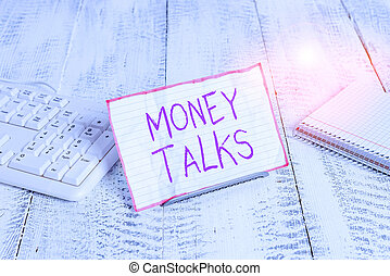 Conceptual hand writing showing Money Talks. Business photo showcasing the wealth gives power and influence to those who possess it Notepaper on wire in between computer keyboard and sheets.