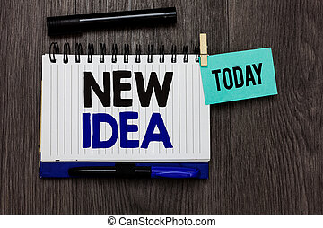 Conceptual hand writing showing New Idea. Business photo text A thought or conception refer to a product of mental activity Ideas notebook wooden table markers for today important reminder.