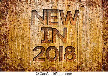 Conceptual hand writing showing New In 2018. Business photo showcasing upcoming year resolution Advertising new product Specs Wooden background wood colour beautiful templates message.