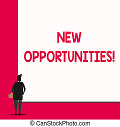 Conceptual hand writing showing New Opportunities. Business photo text exchange views condition favorable for attainment goal Man stands in back view in front of huge big rectangle board.