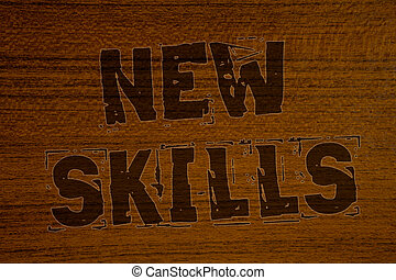 Conceptual hand writing showing New Skills. Business photos showcasing Recently Acquired Learned Abilities Knowledge CompetencesBold brown letters words ideas on wooden background concept messages.