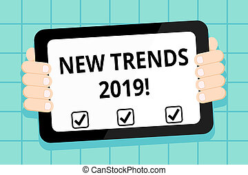 Conceptual hand writing showing New Trends 2019. Business photo showcasing general direction in which something is developing Color Tablet Smartphone with Screen Handheld Back of Gadget.