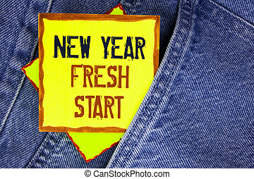 Conceptual hand writing showing New Year Fresh Start. Business photo showcasing Time to follow resolutions reach out dream job written on Yellow Sticky Note Paper on the Jeans background.