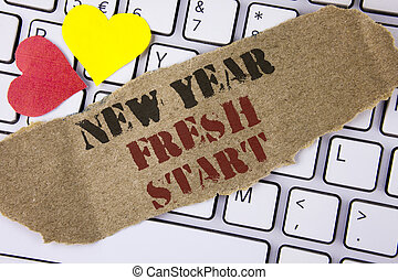 Conceptual hand writing showing New Year Fresh Start. Business photo text Time to follow resolutions reach out dream job written on Tear Cardboard Piece placed on the Laptop Hearts.
