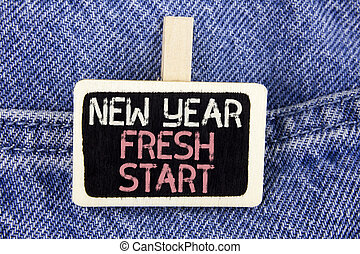 Conceptual hand writing showing New Year Fresh Start. Business photo text Time to follow resolutions reach out dream job written on Wood Piece on the Jeans background.