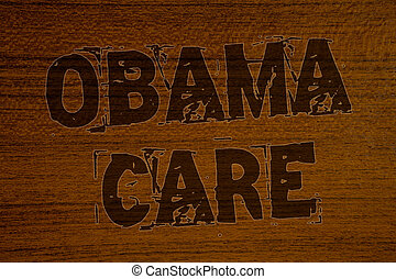 Conceptual hand writing showing Obama Care. Business photos showcasing Government Program of Insurance System Patient ProtectionBold brown letters words ideas on wooden background concept messages.