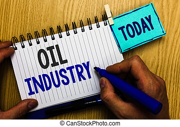 Conceptual hand writing showing Oil Industry. Business photo showcasing Exploration Extraction Refining Marketing petroleum products Man holding marker expressing ideas notebook reminder wood.