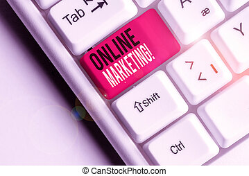 Conceptual hand writing showing Online Marketing. Business photo showcasing leveraging web based channels spread about companys brand White pc keyboard with note paper above the white background.