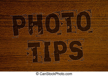 Conceptual hand writing showing Photo Tips. Business photos showcasing Suggestions to take good pictures Advices for great photosgraphyBold brown letters words ideas on wooden background.