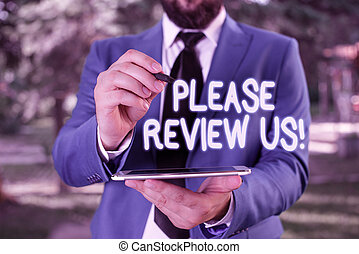 Conceptual hand writing showing Please Review Us. Business photo showcasing situation or system is formal examination by showing authority Businessman in blue suite stands with mobile phone in hands.