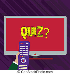 Conceptual hand writing showing Quizquestion. Business photo text Short Tests Evaluation Examination to quantify your knowledge Hand Holding Remote Control infront of Wide Color PC Screen.