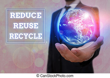 Conceptual hand writing showing Reduce Reuse Recycle. Business photo text environmentallyresponsible consumer behavior Elements of this image furnished by NASA.