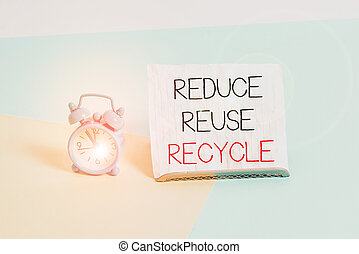 Conceptual hand writing showing Reduce Reuse Recycle. Business photo text ways can eliminate waste protect your environment Alarm clock beside a Paper sheet placed on pastel backdrop.
