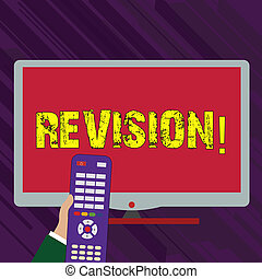 Conceptual hand writing showing Revision. Business photo text Rechecking Before Proceeding Self Improvement Preparation Hand Holding Remote Control infront of Wide Color PC Screen.