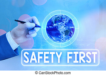 Conceptual hand writing showing Safety First. Business photo text used to say that the most important thing is to be safe Elements of this image furnished by NASA.