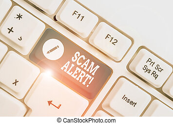 Conceptual hand writing showing Scam Alert. Business photo text fraudulently obtain money from victim by persuading him White pc keyboard with note paper above the white background.