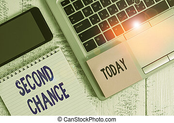 Conceptual hand writing showing Second Chance. Business photo showcasing opportunity to try something again after failing one time Laptop ruled notepad smartphone sticky note on wooden table.
