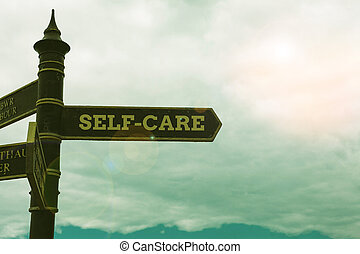 Conceptual hand writing showing Self Care. Business photo text the practice of taking action to improve one s is own health Road sign on the crossroads with blue cloudy sky in the background.