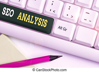 Conceptual hand writing showing Seo Analysis. Business photo showcasing tool helps showing to study on how to improve a website ranking White pc keyboard with note paper above the white background.