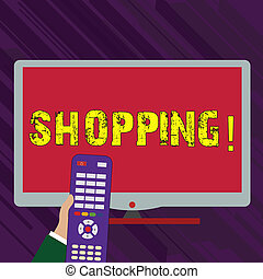 Conceptual hand writing showing Shopping. Business photo text Shopper customer purchase goods products store experience Hand Holding Remote Control infront of Wide Color PC Screen.