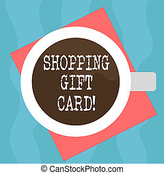 Conceptual hand writing showing Shopping Gift Card. Business photo showcasing piece of paper that you buy at shop and give to someone Top View of Drinking Cup Filled with Beverage on Color Paper.