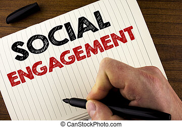Conceptual hand writing showing Social Engagement. Business photo showcasing post gets high reach Likes Ads SEO Advertising Marketing written by Man on Notebook Book on Wooden background Marker.